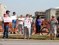 Counter Protestors at a Rally to Secure Our Borders. Counter Protestors with a signs across the street from a Rally to Secure Our Borders in Lincoln, Nebraska at Stock Photo