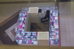 Counter for the sale of jewelery and girl saleswoman. View from above Stock Image