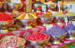 The counter of spice store, Vakil Bazaar, Shiraz, Iran. The counter of the spice store in Vakil Bazaar with large amount of bowls with spices, herbs, dried stock image