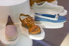 Counter with sport shoes at fashionable shop Stock Image