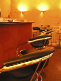 Counter and stools. Warm colored bar interior with counter and bar stools Stock Images