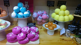 The counter in the store fresh handmade cosmetics Lush. With colourful bubble bath and bombs for the bath royalty free stock image
