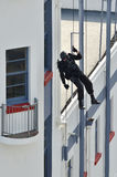 Counter-terrorism police officer abseiling a building Royalty Free Stock Photo
