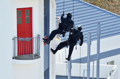 Counter-terrorism police officers abseiling a building Stock Images