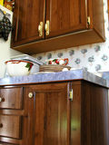 Counter Top. Wood cabinets and counter top with dishes Royalty Free Stock Photo