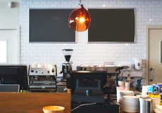 Counter top at a bright cafe with empty blackboards on the wall for copy space. Counter top at a bright modern cafe with empty blackboards on the wall for copy stock photography