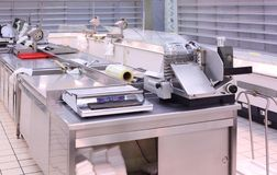 Counter with trading equipment in empty shop Stock Image