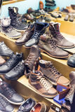 Counter with wintry male shoes. At fashionable shop Royalty Free Stock Photography