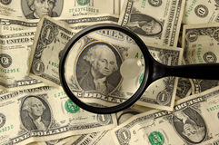 Counterfeit. Photo of Money and Magnifying Glass Royalty Free Stock Photos