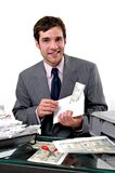 Counterfeit. A man printing counterfeit money to pay bills Royalty Free Stock Photo