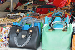 Counterfeit bags. ROME, ITALY – JUNE 29, 2014: Big pile of colorful counterfeit handbags of famous fashion brands sold on Porta Portese flea market in Rome Stock Photo