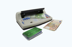Counterfeit detector. Multifunction counterfeit money and credit card detector Stock Photography