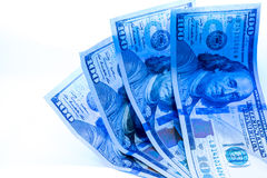 Counterfeit dollar currency detection. Counterfeit dollar currency detection, Checking one hundred dollar banknotes with ultraviolet light or black light Royalty Free Stock Photo