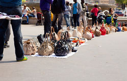 Counterfeit italian bags in the street. Counterfeit italian bags for sales in the street Stock Photography