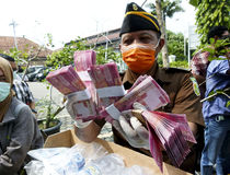 Counterfeit money. Prosecutors showed counterfeit money proceeds of crime in the city of Solo, Central Java, Indonesia Royalty Free Stock Photography