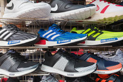 Counterfeit running shoes on market. KUALA LUMPUR - MARCH 14, 2017: Counterfeit sports shoes for sale at the Chinatown market known as Petaling Street. It is Royalty Free Stock Photography