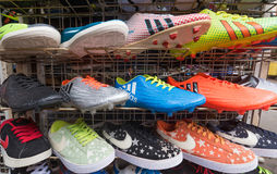 Counterfeit sports shoes on market. KUALA LUMPUR - MARCH 14, 2017: Various counterfeit sports shoes for sale at the Chinatown market known as Petaling Street. It Royalty Free Stock Photos