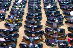 Counterfeit sun glasses at the market Stock Images