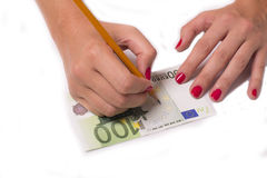 Counterfeiter forges euro Royalty Free Stock Image