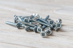 Countersunk wood screws on a wooden background.  Royalty Free Stock Photos