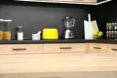 Countertop and blurred view of kitchen interior. On background royalty free stock photo