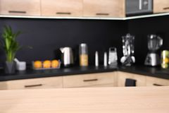 Countertop and blurred view of kitchen interior. On background stock photo