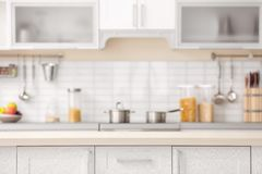 Countertop and blurred view of kitchen interior. On background royalty free stock images