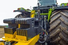 Counterweight mounted behind a powerful, modern tractor royalty free stock image