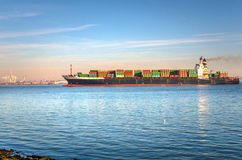 Container Ship in Navigation at Sunrise Stock Image