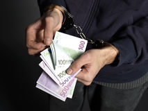 Counting. Money with handcuffs on black background Stock Images