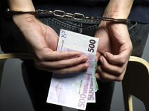Counting. Money with handcuffs on black background Royalty Free Stock Photos