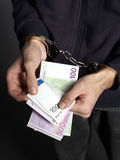 Counting. Money with handcuffs on black background Stock Photo
