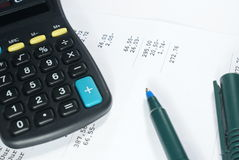 Counting. Calculator and pencil lying on some document with numbers Royalty Free Stock Images