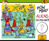 Counting aliens task for kids. Cartoon Illustration of Educational Counting Task for Preschool Children with Aliens Fantasy Characters Stock Image