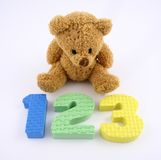 Counting Bear. A bear sitting in front of some numbers Royalty Free Stock Photo