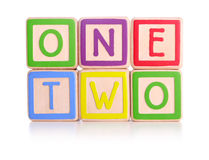 Counting blocks. The words one and two spelled on children's colourful blocks - with clipping path Stock Image
