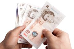Counting British notes Royalty Free Stock Photo