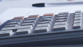 Counting on calculator. Macro. Finger presses the button calculator stock footage