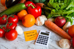 Counting calories. Diet of  vegetables and fruits Royalty Free Stock Image