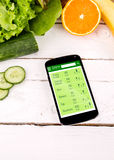 Counting calories in smartphone. Royalty Free Stock Images