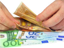 Counting cash. Man's hands counting euro notes, isolated Royalty Free Stock Images