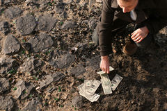 Counting cash on the ground Stock Images