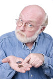 COUNTING CHANGE 2. Old Man expression with coins in his hand Royalty Free Stock Images