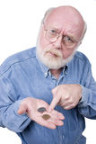 COUNTING CHANGE. Old Man with coins in his hand Royalty Free Stock Photos