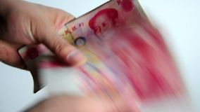 Counting China Yuan stock footage