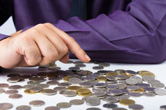 Counting coins Stock Photography