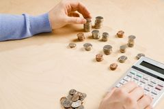 Counting coins Royalty Free Stock Image