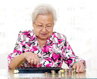 Counting coins Stock Images