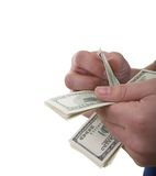 Counting dollars. Two hands of the man counting money isolated Royalty Free Stock Photography