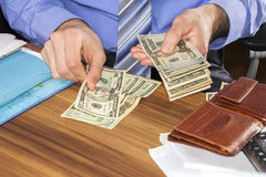 Counting dollars banknotes Royalty Free Stock Images
